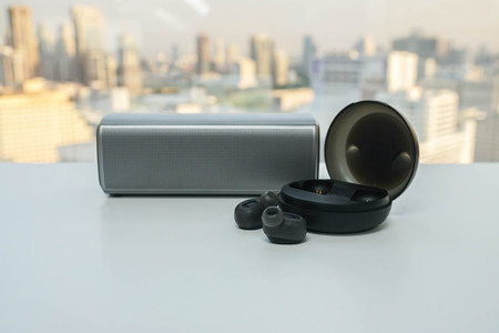 isolated portable  speaker and wireless earphone with trendy case for music Фото со стока