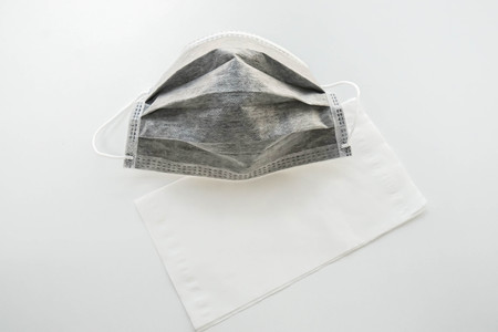 isolated carbon mask with tissue paper for pollution prevention for health Фото со стока
