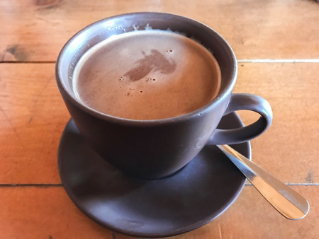 a cup of hot chocolate drink for warmth in winter