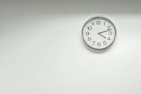 isolated round clock on office wall Фото со стока