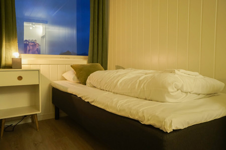 single bed in small bedroom in hostel for rest