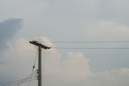 tall electricity pole with cable wire