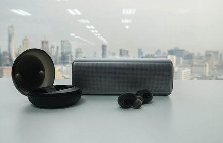 portable speaker and wireless earphone with black trendy case for music listening