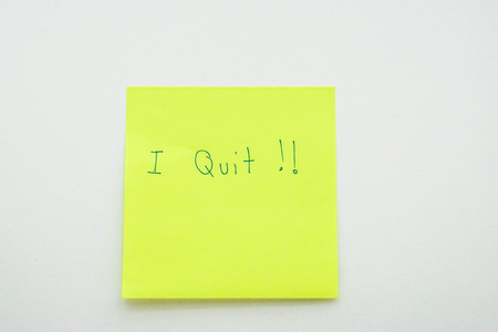business situation concept of resignation in office - isolated I quit message on postit paper in workplace