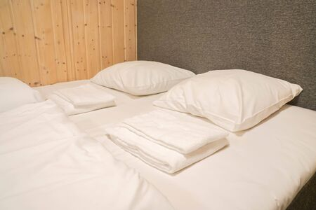 white mattress and comfortable pillows in hotel double bedroom for couple honeymoon