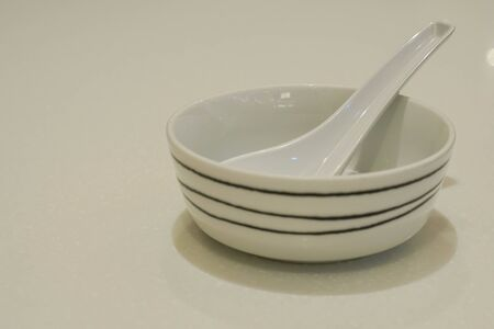 isolated ceramic bowl with spoon for hot soup Stock Photo