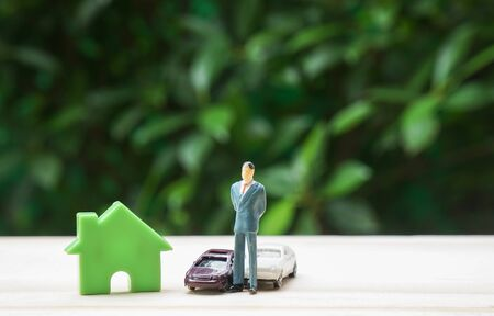 prosperity concept of successful businessman with house and luxury cars Stock Photo