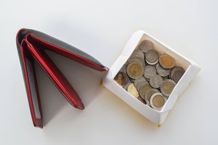 saving money for future concept - isolated Thai Baht coin in a box with men leather wallet