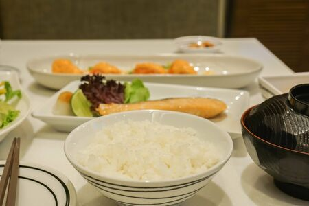 selective focus on white Japanese rice with grilled salmon for lunch in restaurant