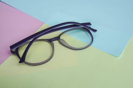 blue light cut protection violet cute women eyeglasses on pastel background Stock Photo