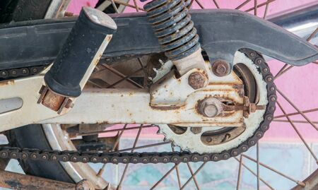 close up old rusty chain and motorcycle parts