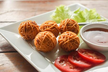 close up Thai traditional fried pork ball with noodles Stock Photo