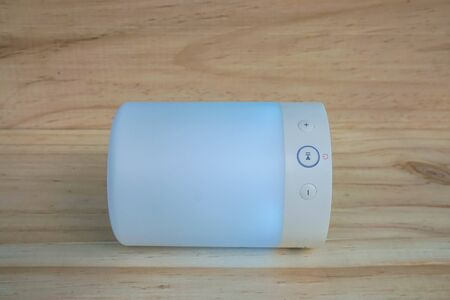 glowing modern wireless speaker in blue color with light function for music player