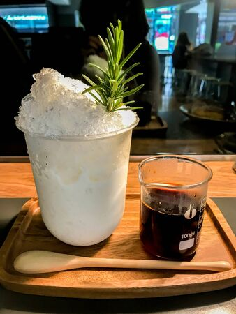 Thai traditional tea with ice in creative decorated cup