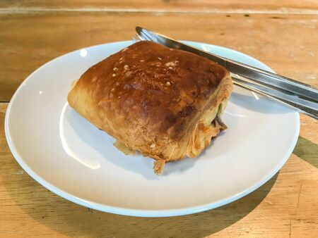 baked white chocolate puff on white plate for breakfast