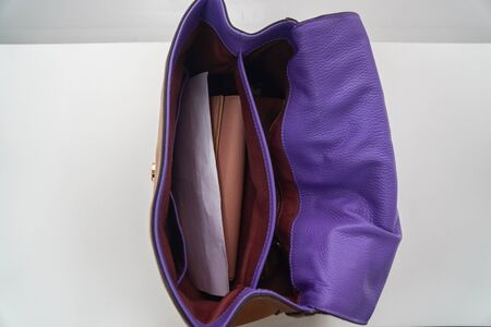 close up inside the fashionable leather bag for women working with stuff
