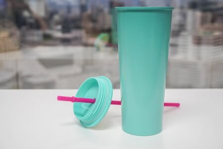 save the world and sea life concept by use glass for coffee to reduce the plastic waste