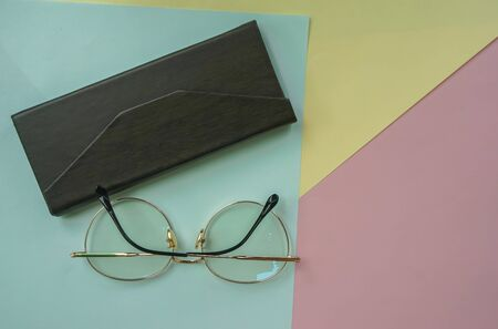 women eyeglasses for blue light protection with leather case on pastel background Stock Photo