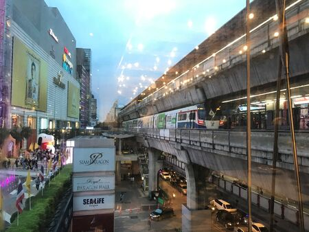 Bangkok  Thailand - June 6 2019: sky train at BTS Siam station and Parc Paragon with people for hanging out and shopping in the evening