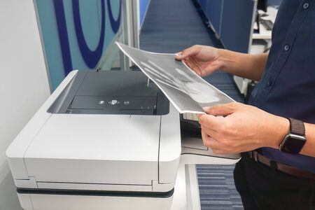 businessman hold paper with finger print for copying at office printer Фото со стока