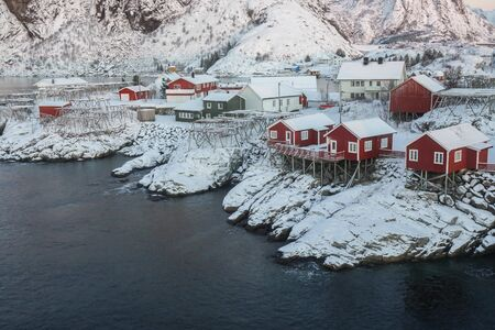 close up red rorbuer covered with snow along the Norwegian Sea in winter