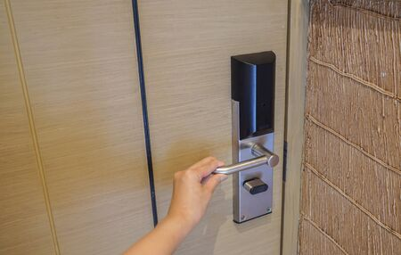 close up woman twist the hotel doorknob for bedroom entrance