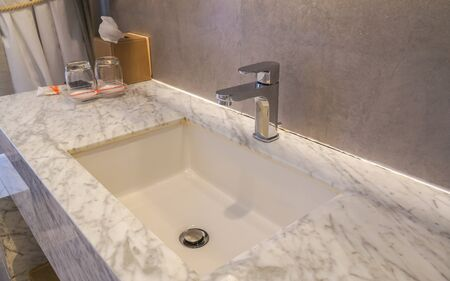 faucet and luxury marble washbasin in hotel bathroom Stock Photo