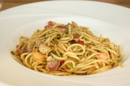 selective close up spicy seafood spaghetti in white plate for serving customers Stock Photo