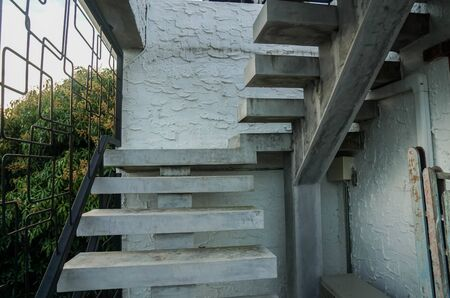 vintage concrete outdoors stairway at loft building Stock Photo