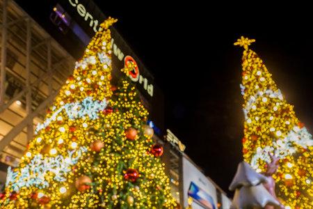 Bangkok  Thailand - November 12 2019: bokeh and defocus Glow and illuminating Christmas tree for New Year Festival celebration Editorial