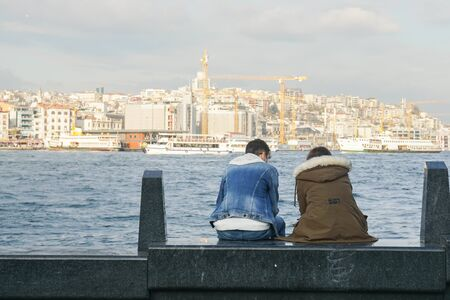 young couple sit in the seaside at Bosphorus Cruise Tours Istanbul