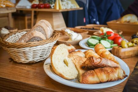 close up selective focus Turkish traditional breakfast of baked bread with vegetable and cheese Stock Photo
