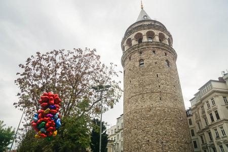 Istanbul  Turkey - December 9 2019: Galata tower with floating heart shape balloon in Taksim