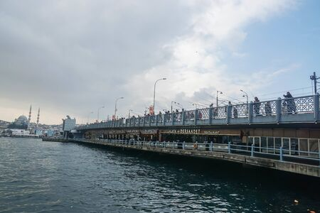 Istanbul  Turkey - December 09 2019: people make a living by fishing at Galata Bridge