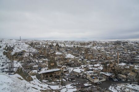 Cappadocia  Turkey - December 10 2019: top view of Cappadocia city covered with first snow in winter