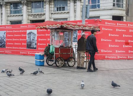 Istanbul  Turkey - December 09 2019: merchant of traditional street food shop with customer at Galata pier