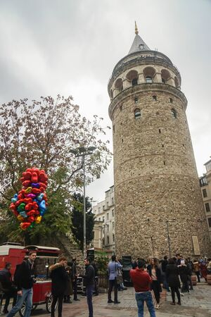 Istanbul  Turkey - December 9 2019: Galata tower with people and floating heart shape balloon in Taksim