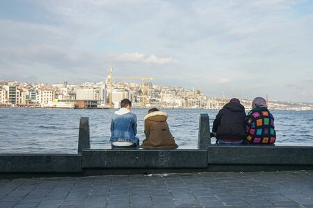 selective focus lover and old couples sit on the bench at Black sea in holiday