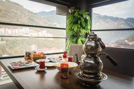 Trabzon  Turkey - traditional breakfast Turkey with Turkish tea pot on wooden table in hotel Editorial