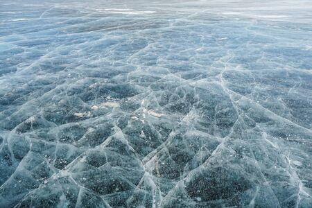 crack thick ice crystals at Baikal lake in winter season