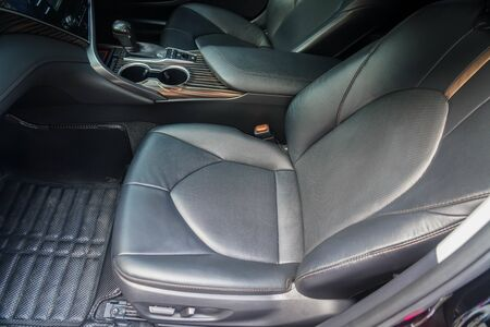 close up leather passenger seat in the luxury car