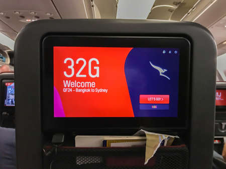 Bangkok / Thailand - December 10 2019: passenger screen on seat with welcome on board message Editorial