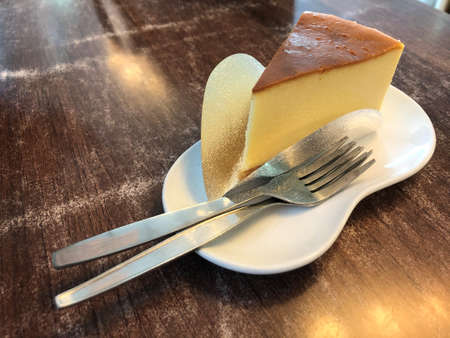 selective focus New York cheesecake on white dish as women favorite Standard-Bild