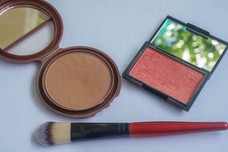 isolated pink glow blush and bronzerwith make up brush for woman make up and beauty
