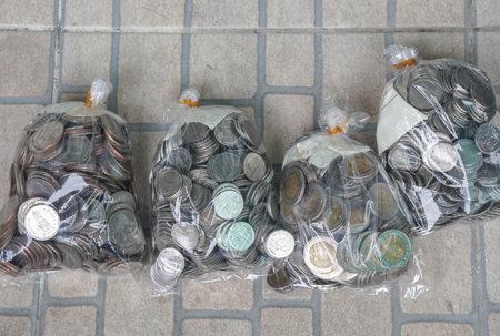 Bangkok / Thailand - September 1 2020: Thai Baht coins in bags for money saving for future plan