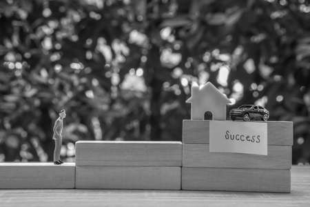 life success concept - black and white business people work for success to own house and car Stock Photo