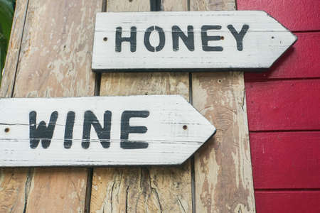 vintage wooden tag of honey and wine in restaurant