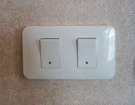 close up selective focus on light switch button panel at the house wall Stock Photo