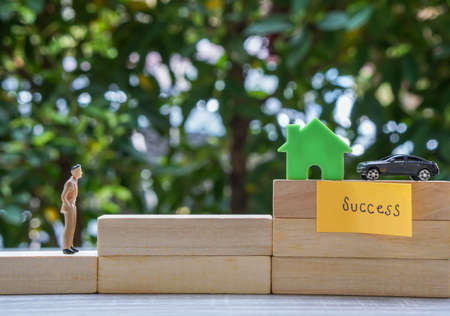 success life concept - close up business people work for success to own house and car steps by steps Stock Photo