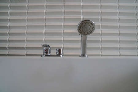 shower hose with hot and cold faucet on the bathtub